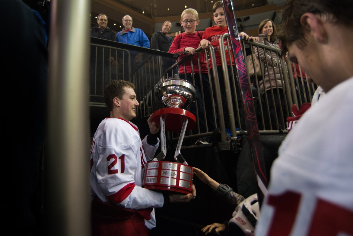 Senior Dwyer Tschantz will join the Worcester Railers of the ECHL. Above, he celebrates with the Kelly-Harkness Cup after the Red beat B.U. in New York in November.