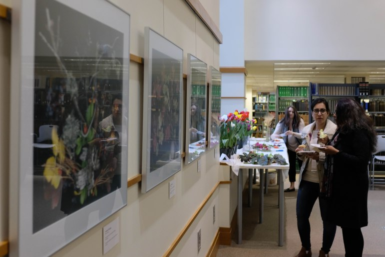 "Mann Library Gallery hosted a reception on Wednesday for its new exhibit, ""A Sweep of Light."" (Michael Wenye Li/Sun Assistant Photography Editor)"