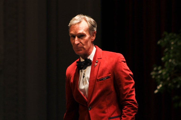 Bill! Bill! Bill! Bill! Bill Nye dons alma mater Cornellian red while presenting about his endeavors.