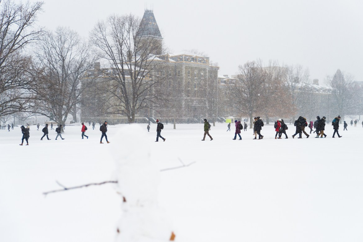 Students trudge through Arts Quad in a heavy snow on Wednesday.