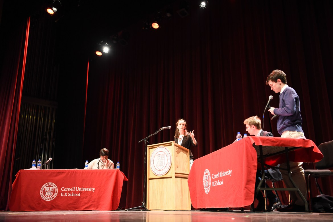 Cornell debaters Brittany Garcia '19 and Adnan Muttalib '16 grad debated Harvard students Archie Hall and Danny DeBois at the event on Thursday evening at the State Theater.