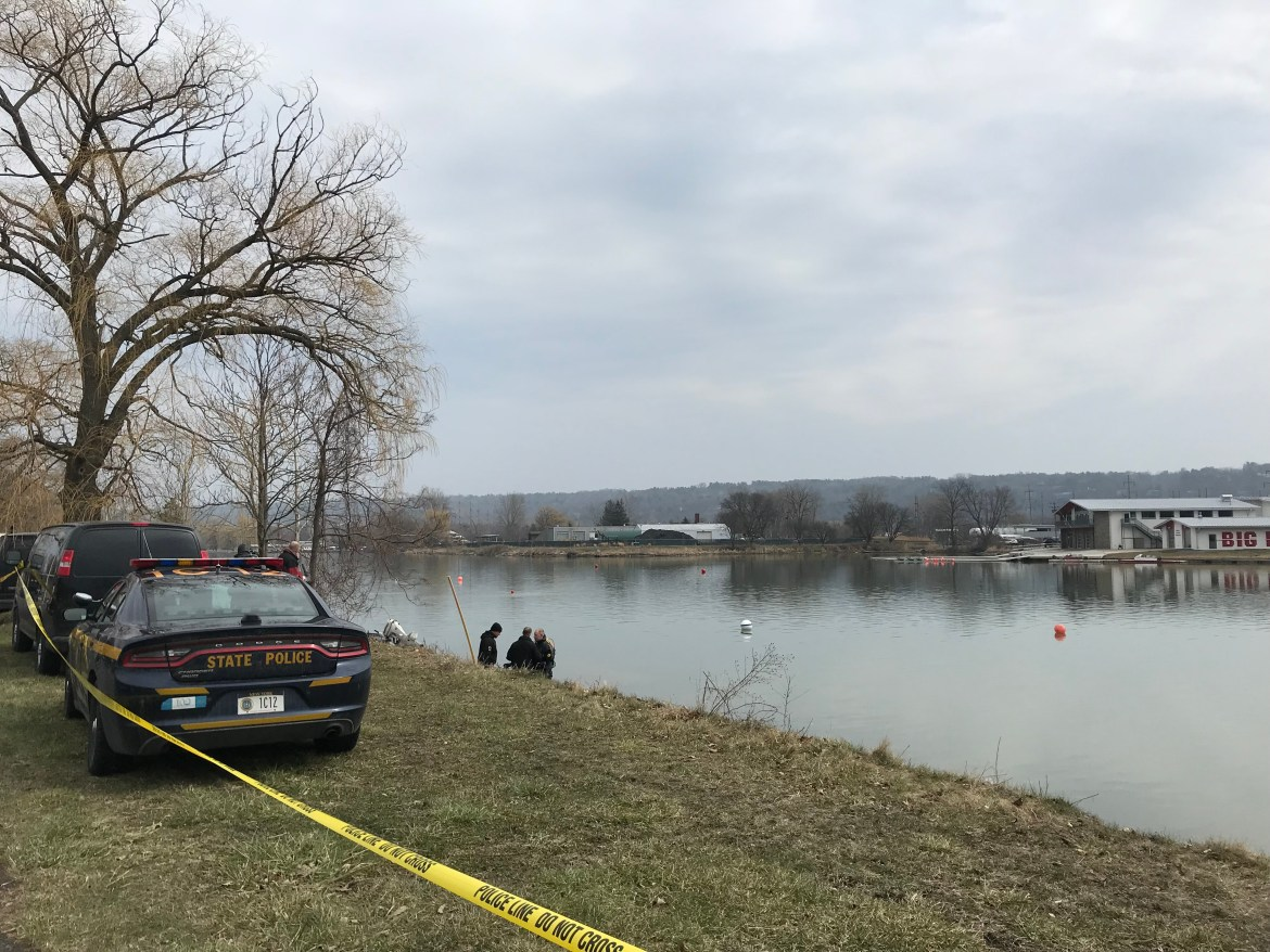 New York State Police divers search the Cayuga Inlet, where they found a handgun connected to Reynolds in April 2018.