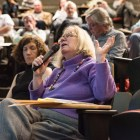Faculty senate members voice their opinions on the proposed at a meeting on April 26.