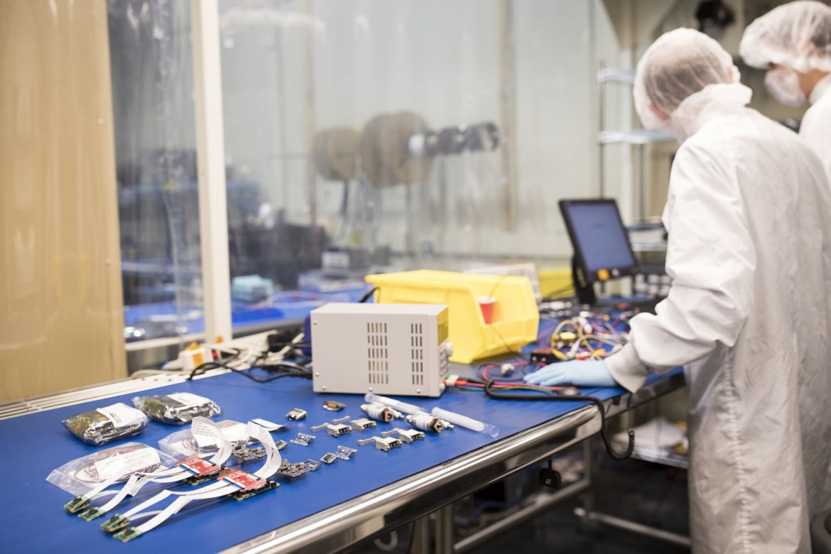 Pathfinder for Autonomous Navigation team members perform tests on spacecraft batteries