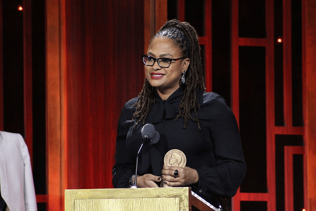 Ava DuVernay, pictured above winning a Peabody award, will be the 2018 Convocation Speaker.