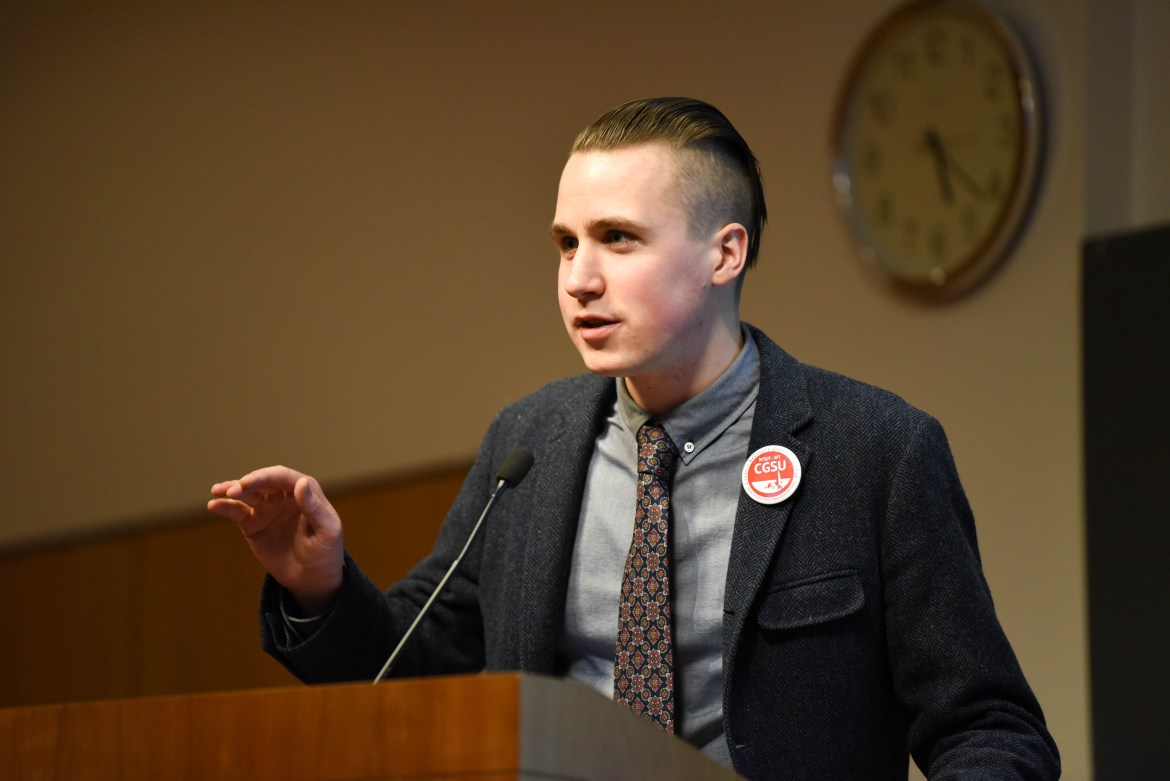 Jaron Kent-Dobias grad speaks at a CGSU meeting on Feb. 15, where CGSU members finalized their objections and remedies for arbitration. CGSU met again on Thursday after the arbitrator released his findings on Wednesday.