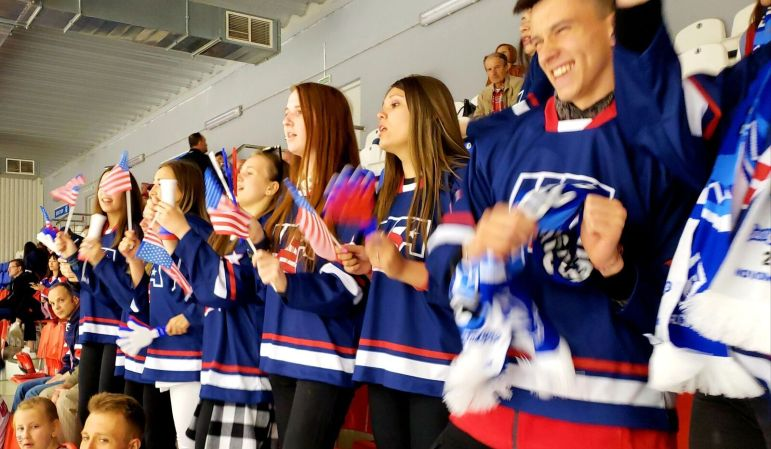 A group of Russian students assigned to cheer on the Capitals fulfills its role from the stands.