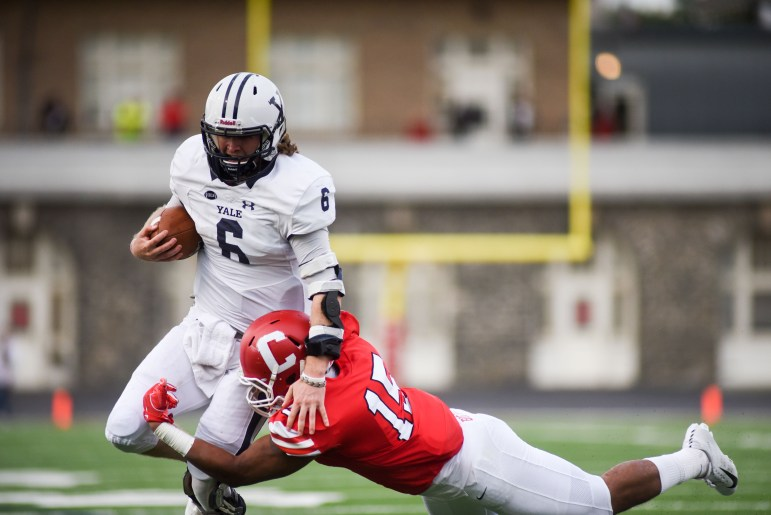 Yale's Kurt Rawlings attempts a rush in the win over Cornell Saturday. A roughing the passer call on the Red gave Rawlings and the Yale offense the chance for its game-winning touchdown.