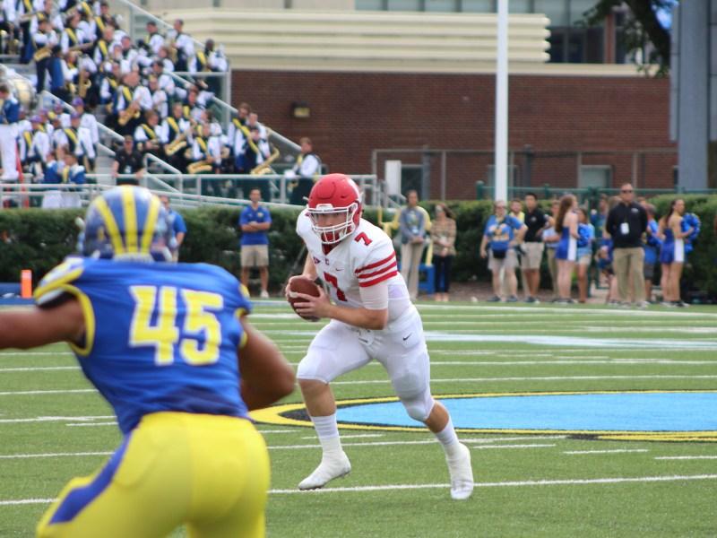 Senior quarterback Dalton Banks attempts a rush in Saturday's loss to Delaware. It was the first showing of Cornell's three-quarterback system.