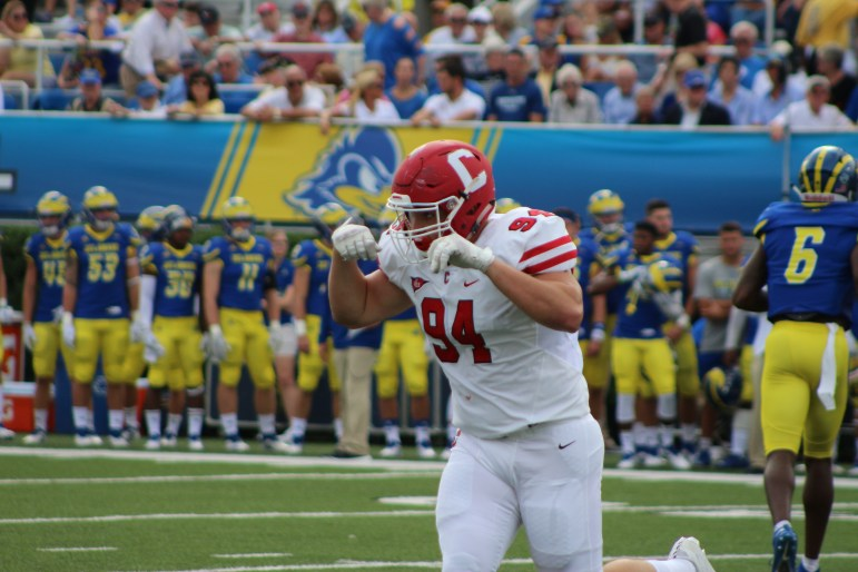 Junior defensive lineman Jordan Landsman celebrates a failed third down conversion for Delaware. The Cornell defense started well and kept the game within reach but was ultimately burned by big plays.