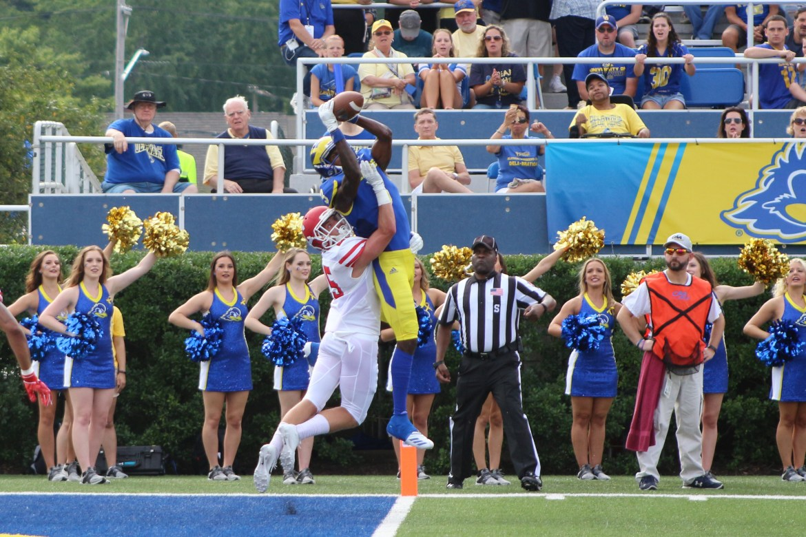Delaware's Joe Walker catches a touchdown over Cornell junior cornerback David Jones in the first quarter Saturday. Walker had 154 receiving yards against the Red.