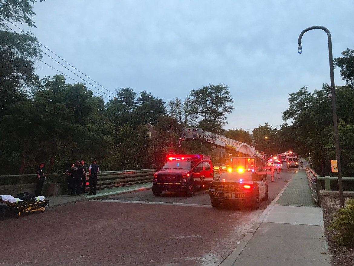 Ithaca firefighters used a ladder as one rappelled over the west side of the Stewart Avenue bridge on Monday evening to rescue a man who had fallen onto a net that hangs below.