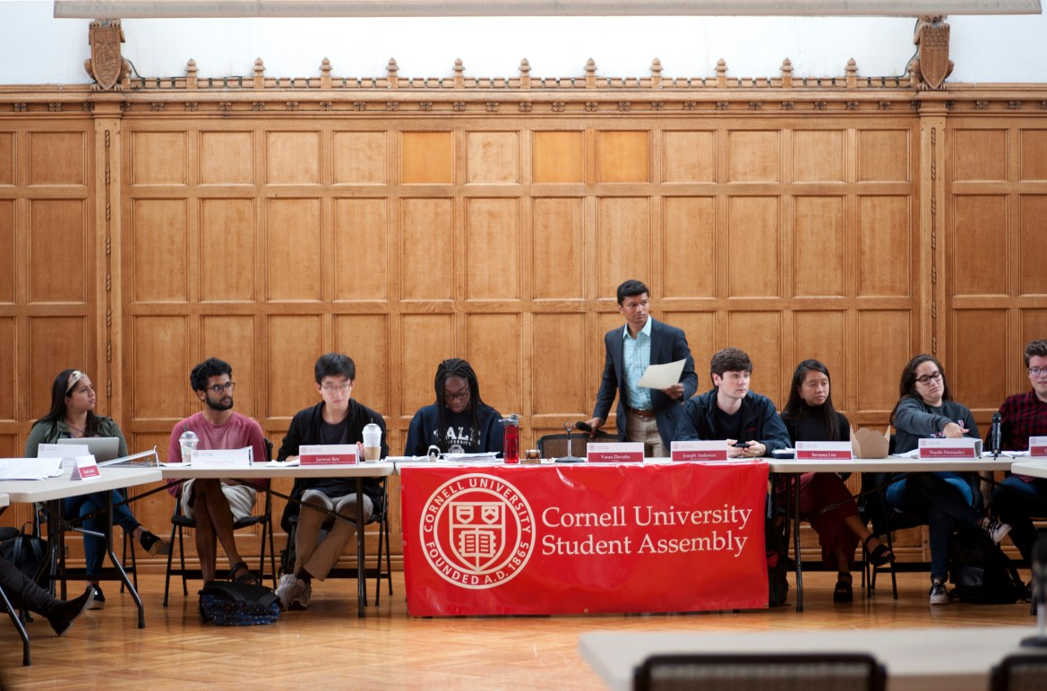 S.A. President Varun Devatha '19 takes a seat as the Sept. 28 Student Assembly meeting commences.