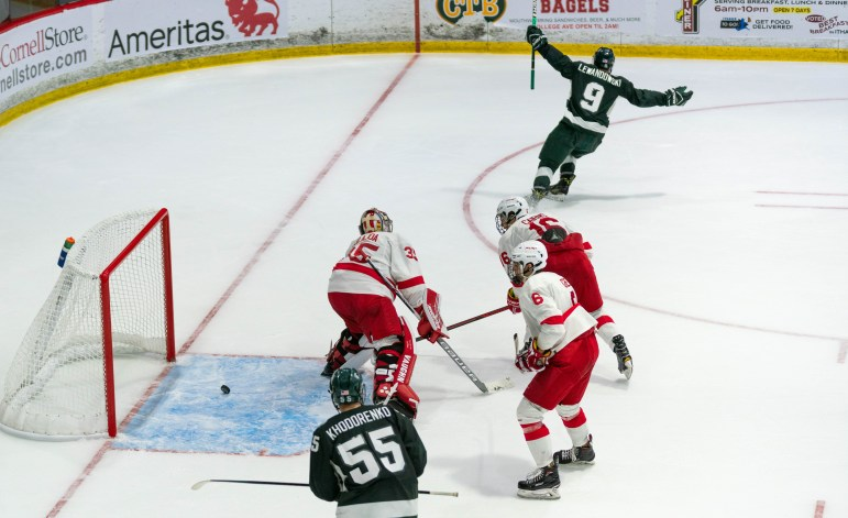 Sophomore goaltender Matt Galajda concedes his fourth goal of the night at Cornell's second game against Michigan State on Saturday. The Red continued to struggle after its crushing defeat on Friday, ultimately losing both games to start the season 0-2. (Jose Covarrubias / Sun Staff Photographer)