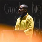Students perform at the Candle Night Gathering on Tuesday, sharing stories about diversity.