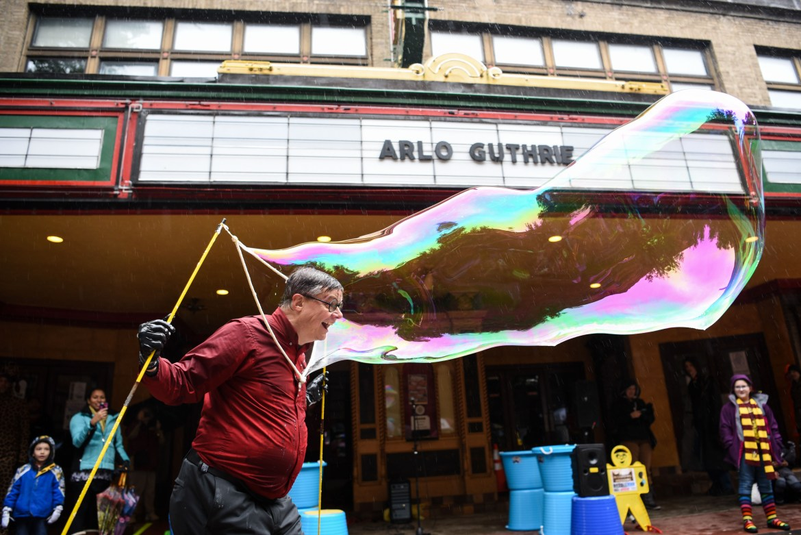 Entertainers performed all sorts of almost-magical tricks for the crowds despite the rain.