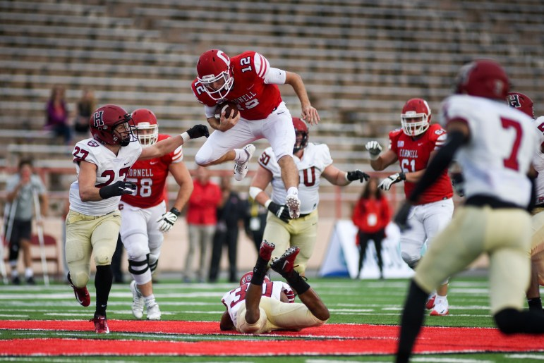 Junior quarterback Mike Catanese hurdles a defender for a gain in Cornell's win over Harvard. The Crimson successfully stymied the run for most of the game, but Catanese and Coles found some holes.