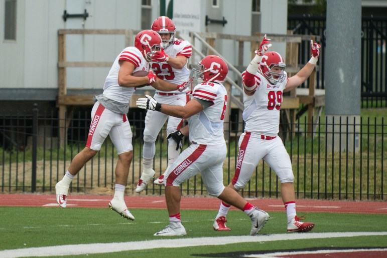 Collin Shaw '16 (far left) and his teammates celebrate the game winning touchdown with under a minute remaining two years ago against Colgate.