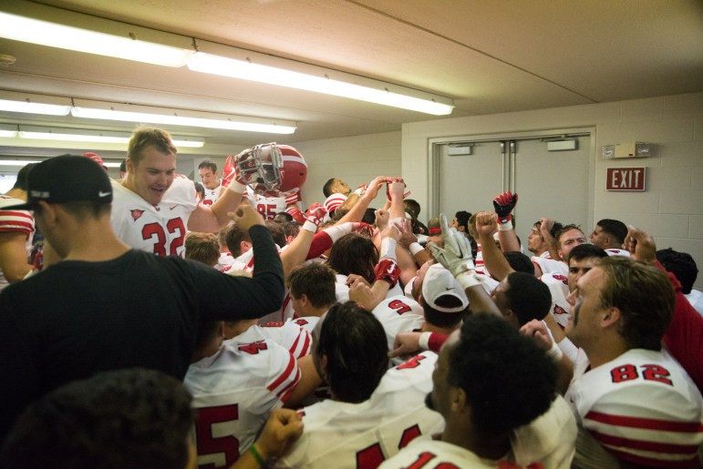 Cornell celebrates the win in the locker room after the game. After trailing 28-5 at one point, the Red came back to beat Colgate, 39-38.