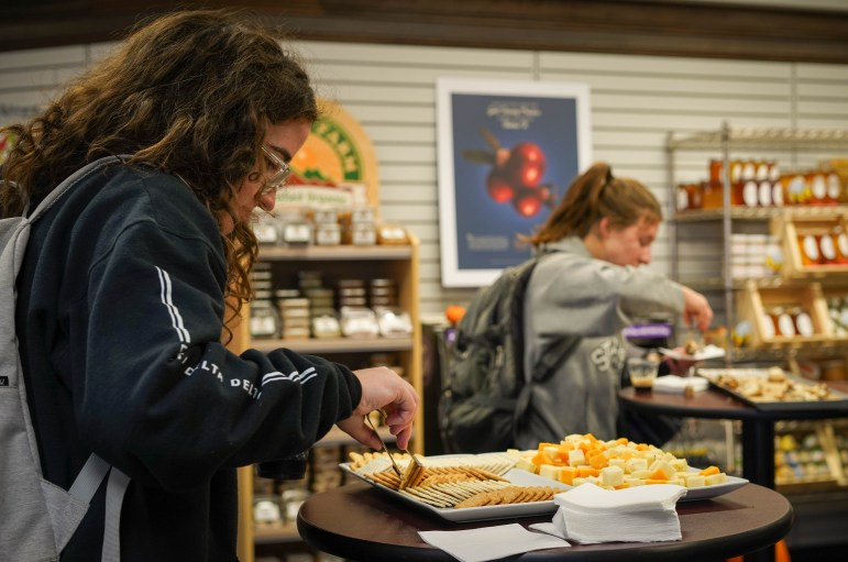 Visitors sampled coffee, kombucha and snacks at the grand opening of the remodeled Market at Café Jennie in the Cornell Store on Thursday. (Jing Jiang / Sun Staff Photographer)