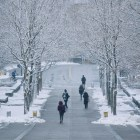 Students walk through the snow on Ho Plaza in March.