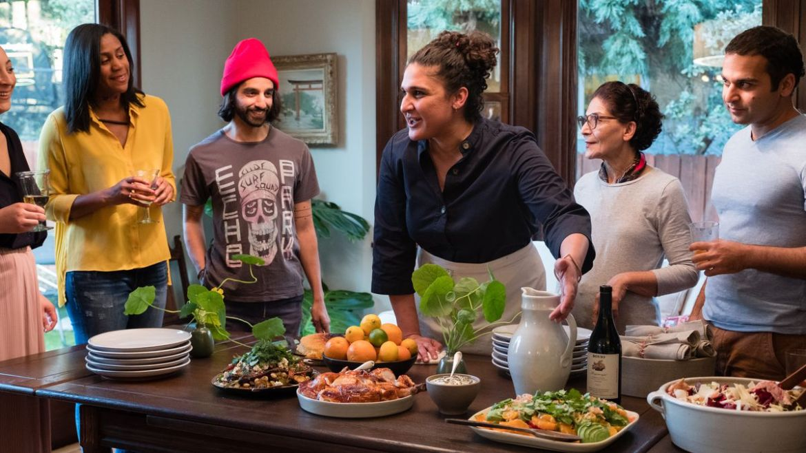 Samin Nosrat cooks for dinner guests in her home.