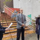 Activists gather outside the old Tompkins Library on Wednesday to raise concerns about the potential release of toxins with the proposed demolition.