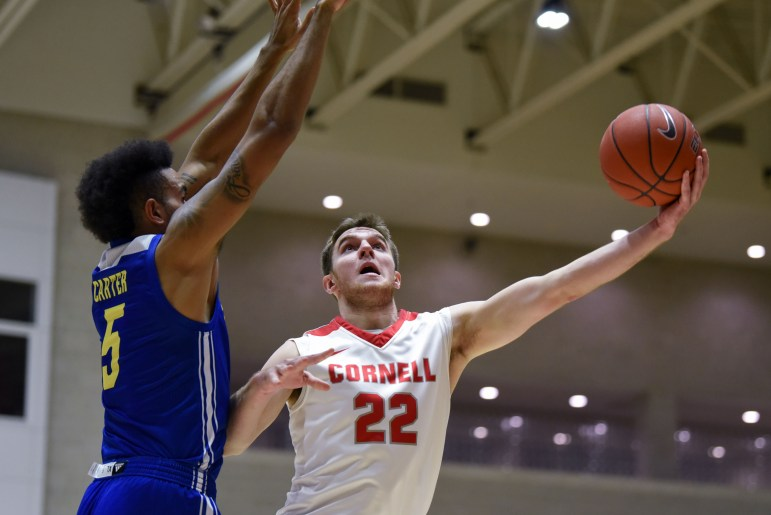 Junior forward Josh Warren puts up a layup at the men's basketball game against Delaware on Thursday. After a 9-2 run by the Blue Hens at the end of the first half, the Red struggled throughout the second half, ultimately falling 73-56. (Boris Tsang / Sun Assistant Photography Editor)