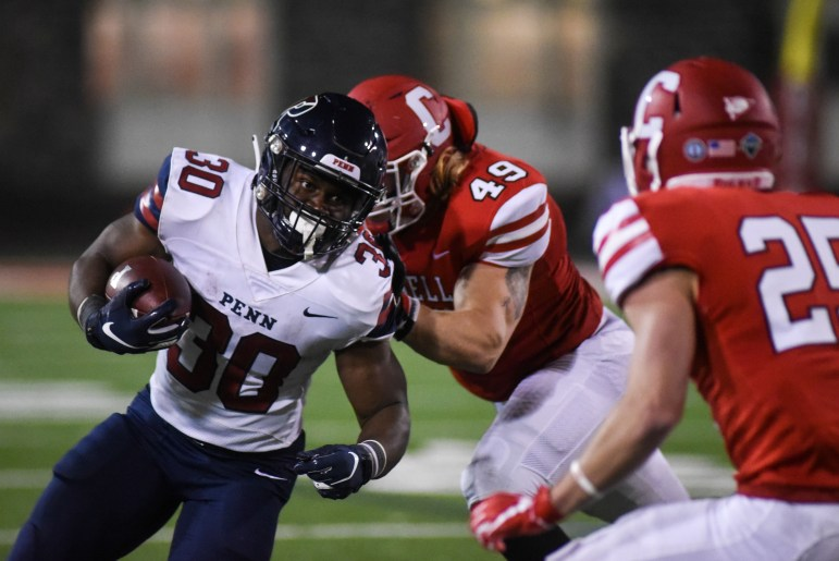 Penn's Karekin Brooks attempts rush for part of his 71 yards on the night.