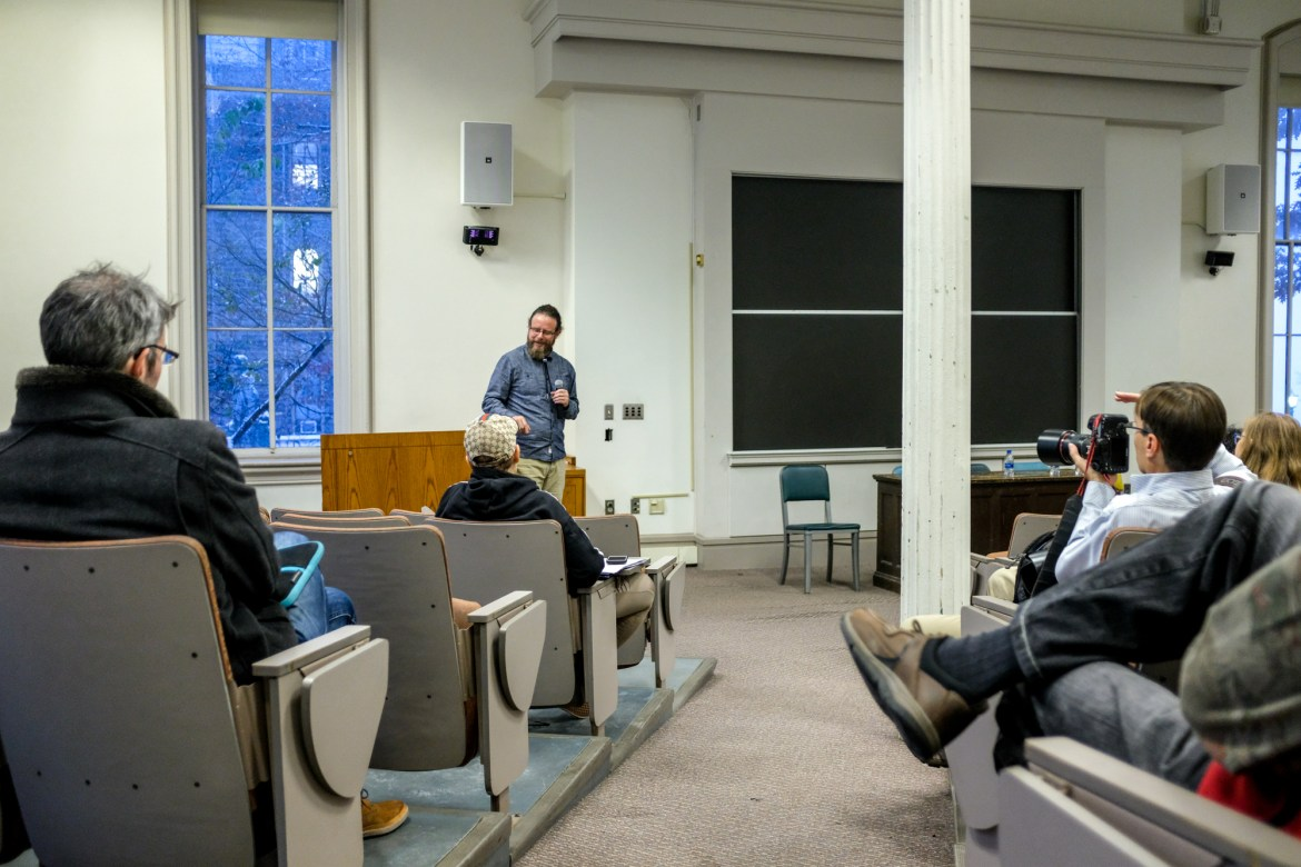 Professors discuss a shift in Cornell's approach to capitalism in McGraw Hall.