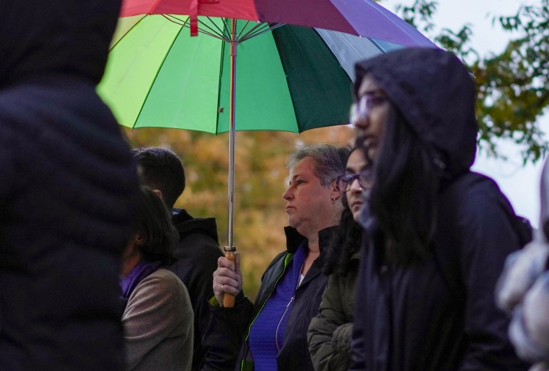 Despite the rain, over 100 community members gathered in front of Goldwin Smith Hall on Monday to show their support for transgender, nonbinary and gender nonconforming people. (Jing Jiang / Sun Staff Photographer)