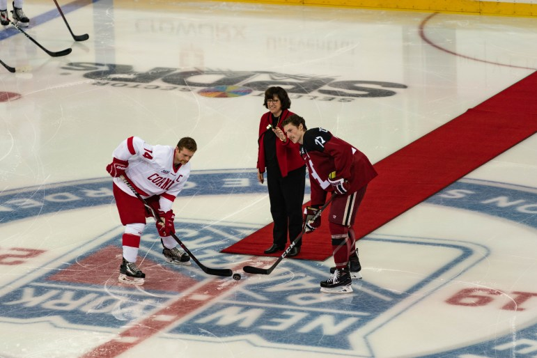Cornell President Martha Pollack drops the ceremonial opening faceoff at Madison Square Garden Saturday.