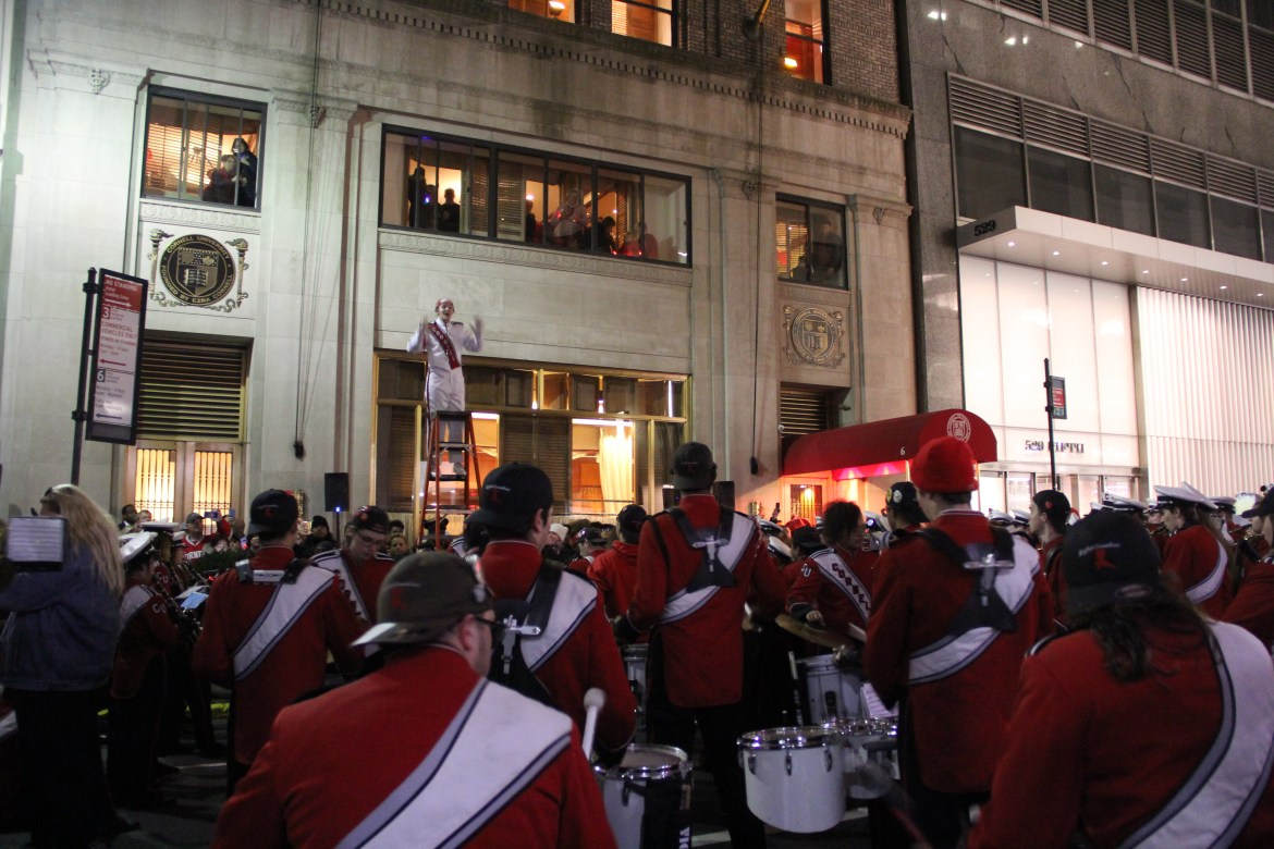 Members of the Big Red Marching Band and Cornell Cheerleaders paraded to the Cornell Club in New York City on Saturday.