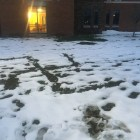 The swastika sign in the snow. Picture taken from the ground floor.