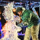 A participant in last year's ice carving competition at Ice Fest blowtorches his sculpture.