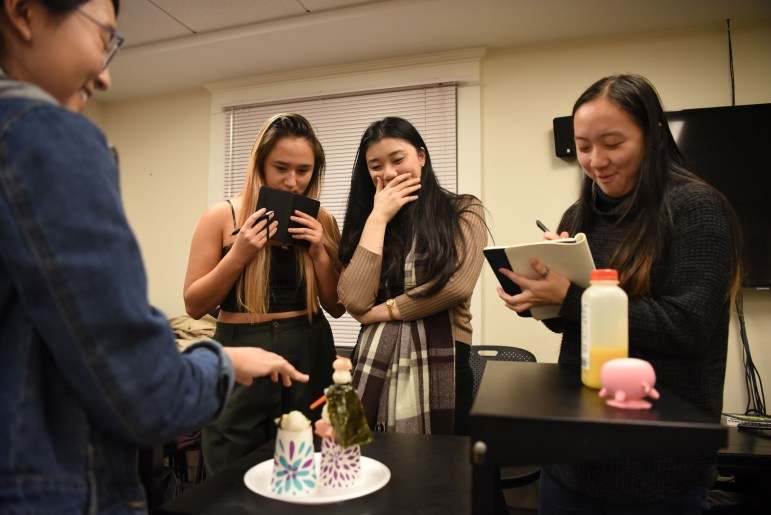 Samantha Chu '22 presents her creation at the Cornell Asian Pacific Student Union's first annual Asian Chopped culinary competition. (Boris Tsang / Sun Assistant Photography Editor)