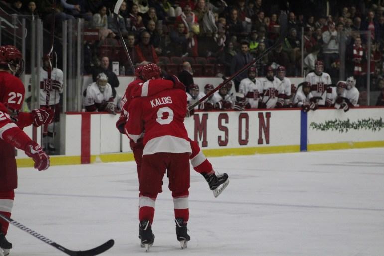 Junior defensean Yanni Kaldis celebrates Cornell's first goal with the goal-scorer, sophomore Cam Donaldson.