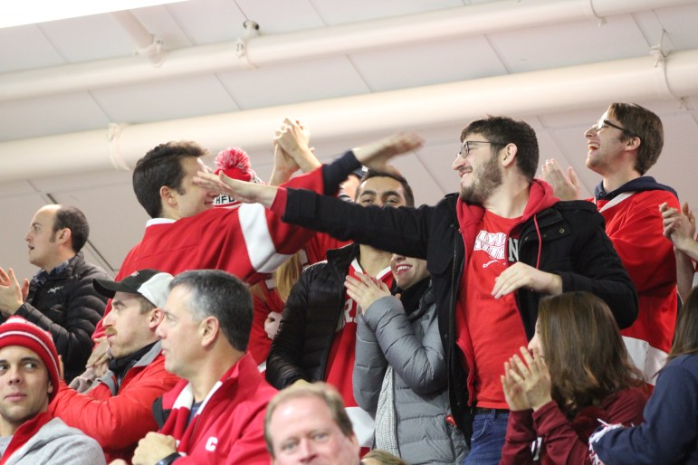 "Cornell fans at ""Lynah East"" celebrate the first goal in the win over Harvard."