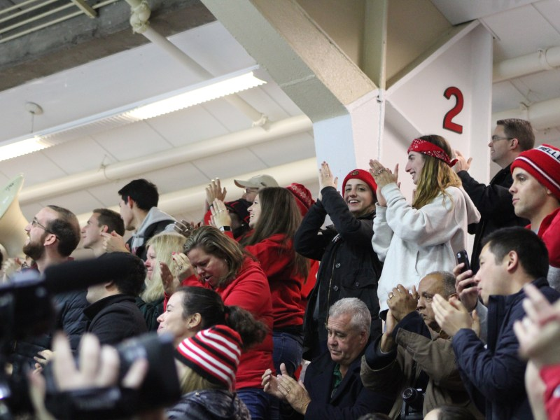 Cornell fans cheer after the Red's second goal — the game-winner from sophomore Tristan Mullin — against Harvard on Saturday night.