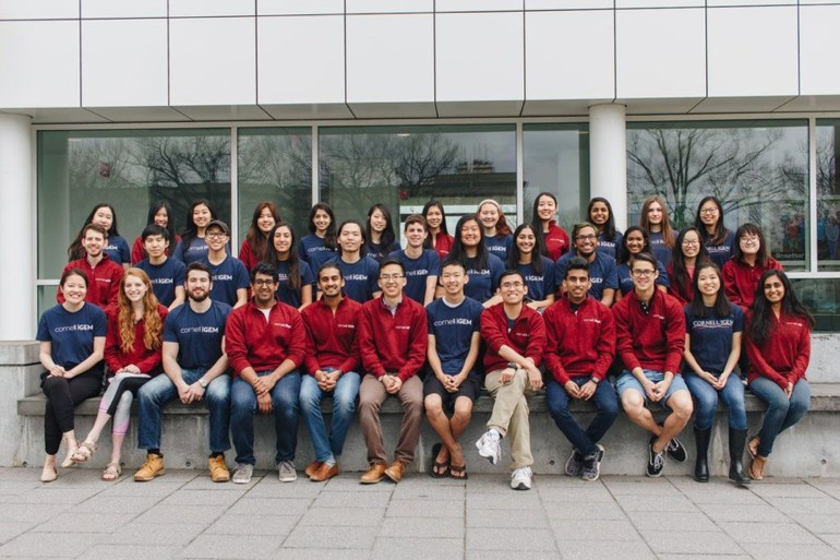Current members of 2018 Cornell iGEM team gather in front of Weill Hall.
