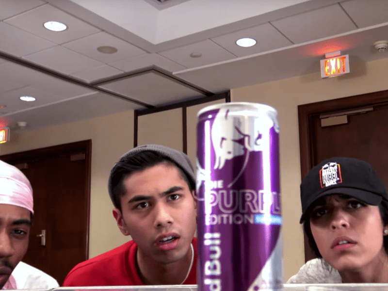 Cornell Dancers Alliance looks at a can of Red Bull in their final round video.