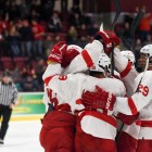 Cornell celebrates freshman forward Michael Regush's game-winning goal in the third period.