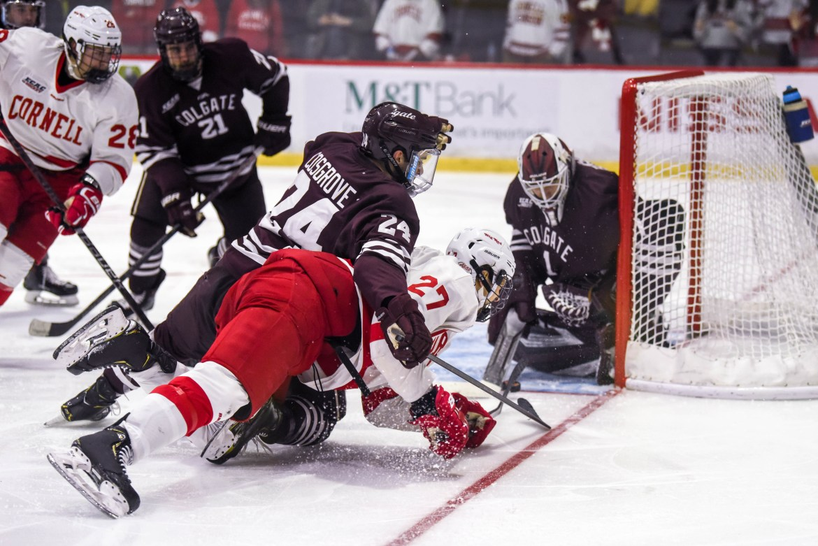 Colgate goalie Mitch Benson (1, above) made 41 saves in his team's 3-2 win over Cornell.