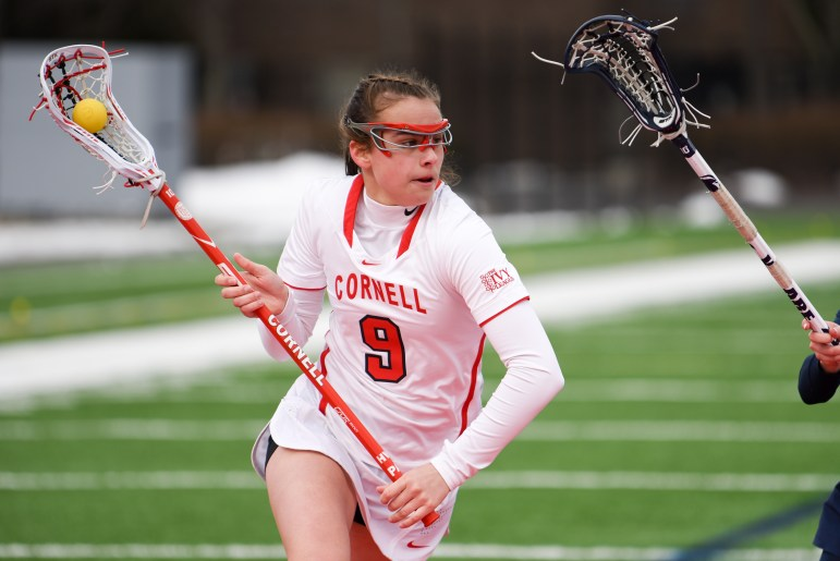 Freshman midfielder Genevieve DeWinter eyes a path to the goal at the women's lacrosse home-opener against Penn State on Saturday. DeWinter scored three goals in the 14-12 loss. (Boris Tsang / Sun Assistant Photography Editor)