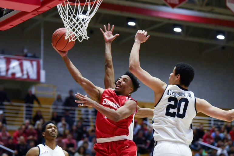 Senior guard Matt Morgan goes to the rim after splitting the Yale defense at the men's basketball game on Saturday. Although Morgan set a Cornell men's basketball Newman Arena record with 35 points, the Red struggled to contain the Bulldogs' offense, falling 98-92. (Boris Tsang / Sun Assistant Photography Editor)