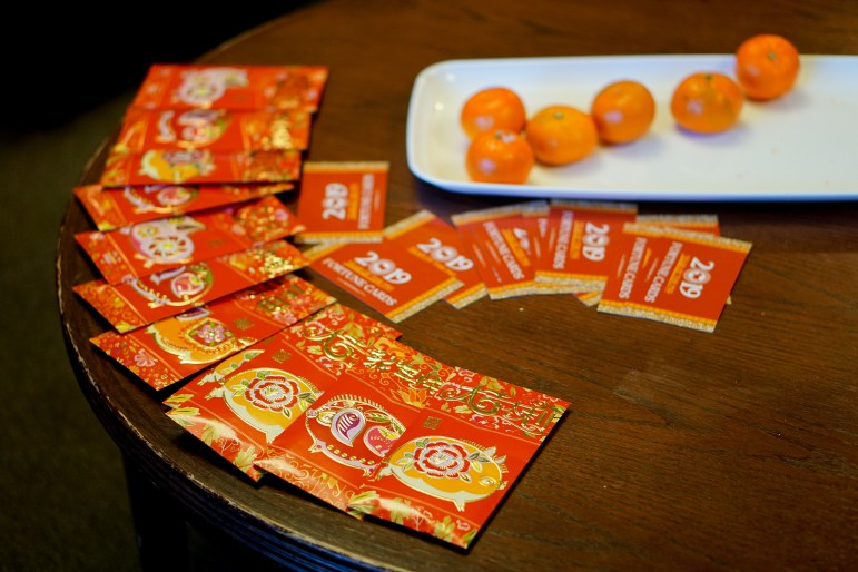 Tatkon Center celebrates Lunar New Year with traditional red envelopes.