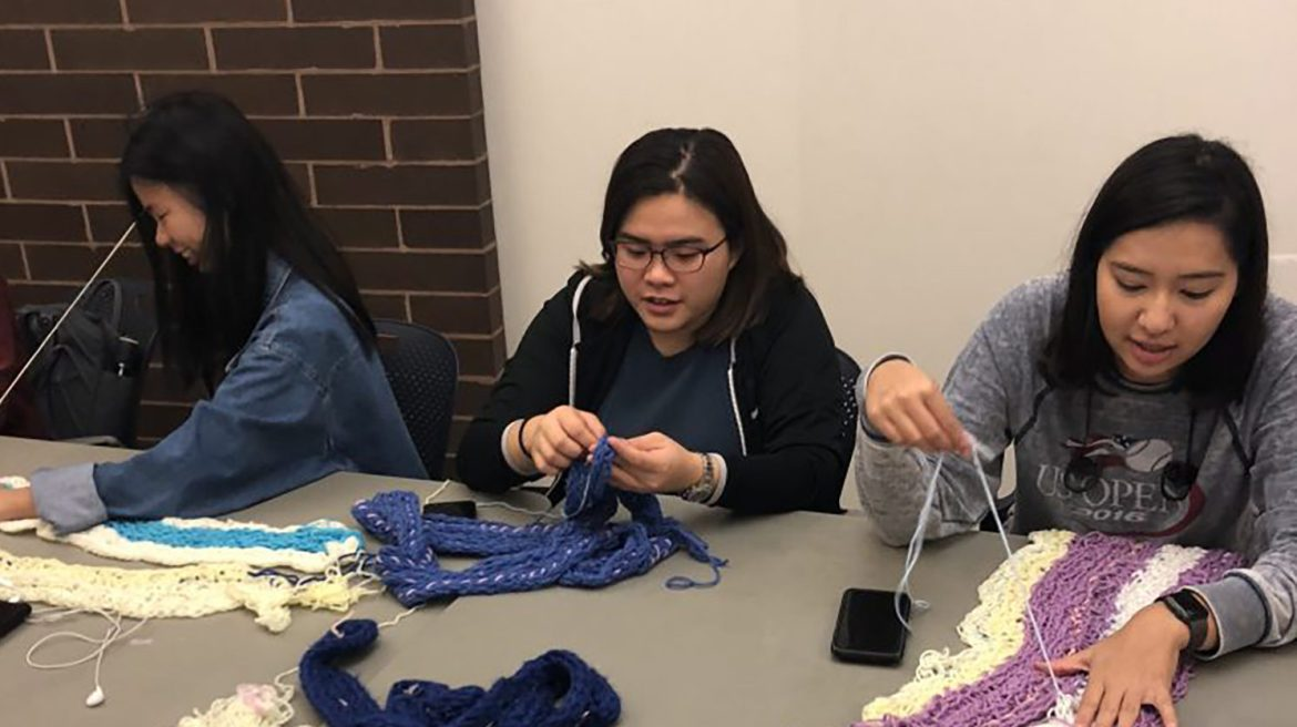 Students gather weekly at the Keeton dorm to finger knit scarves and other wares to benefit the Ithaca community.