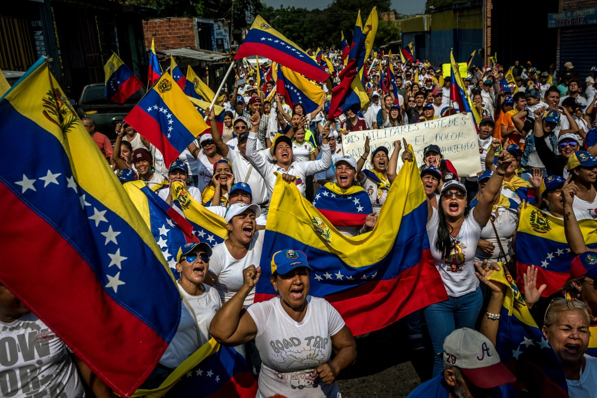 Supporters of opposition leader Juan Guaido march in Pedro Maria Urena, Venezuela, on Tuesday, Feb. 12, 2019. Professor Evelyne Huber of the University of North Carolina at Chapel Hill spoke about the possibility of civil unrest in Latin American counties.