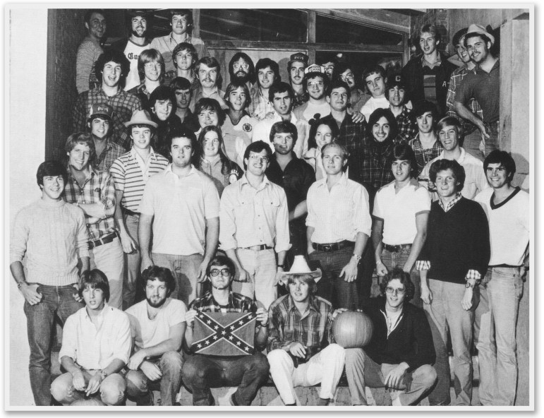 Members of Cornell's Alpha Gamma Rho fraternity pose for a photo in 1981, with one member holding up a Confederate flag.