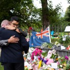 Mourners hugged at a memorial for the victims of the New Zealand mosque shooting.